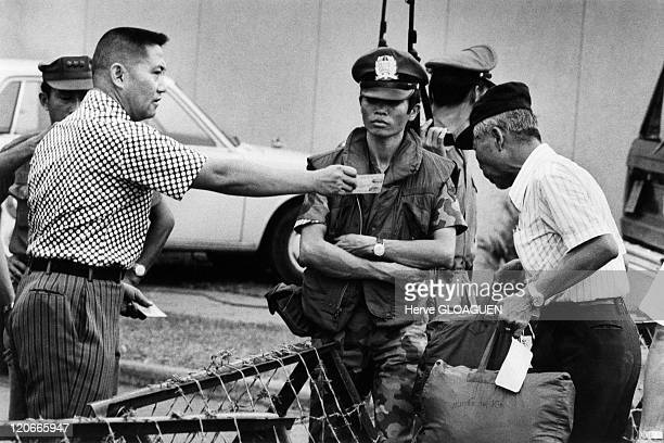 In front of the American Embassy in Saigon Vietnam on April 29 1975 One of the civilians to be evacuated by the helicopters before the fall of the...