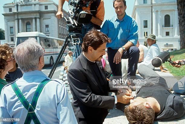 In front of the camera Italian actor Massimo Dapporto rehearsing a scene of the TV series Un prete tra noi under the eyes of Italian director and...