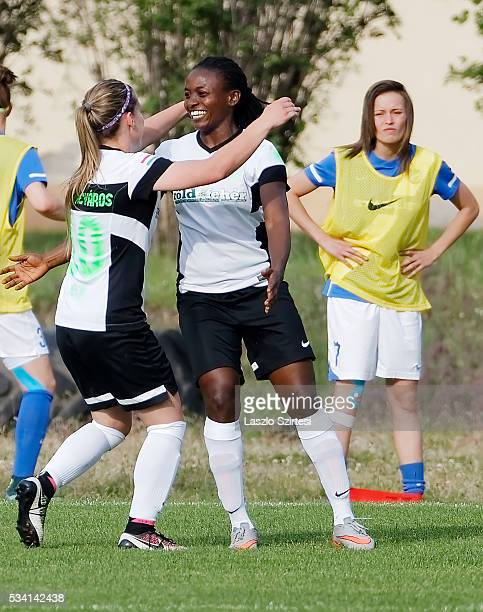 In front of the disappointed Fanni Dioszegi of MTK Hungaria FC Ebere Orji of Ferencvarosi TC celebrates scoring her team's first goal with Jelena...