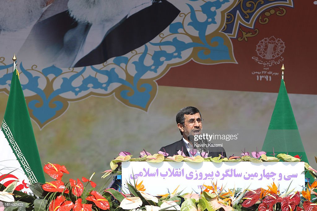 In front of the pictures of Ayatollah Khomeini (L) and Ayatollah Khamenei, Iranian president <a gi-track='captionPersonalityLinkClicked' href=/galleries/search?phrase=Mahmoud+Ahmadinejad&family=editorial&specificpeople=221337 ng-click='$event.stopPropagation()'>Mahmoud Ahmadinejad</a> addreses the crowd with a controversial speech during the 34th anniversary of the Islamic revolution on February 10, 2013 in Tehran, Iran.