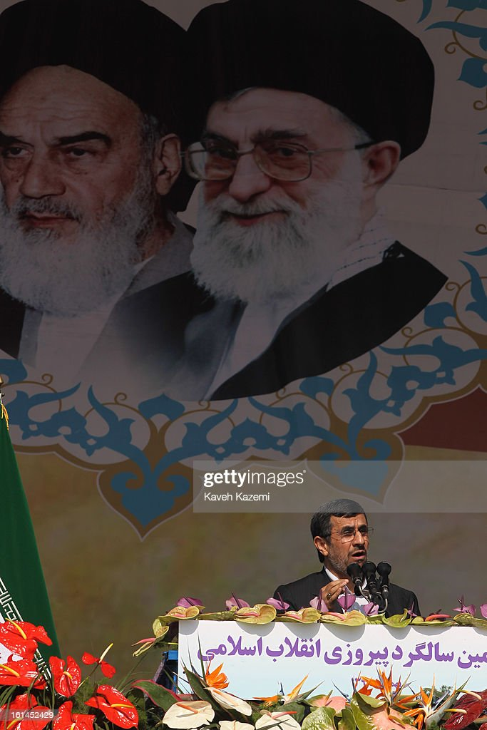 In front of the pictures of <a gi-track='captionPersonalityLinkClicked' href=/galleries/search?phrase=Ayatollah+Khomeini&family=editorial&specificpeople=226737 ng-click='$event.stopPropagation()'>Ayatollah Khomeini</a> (L) and Ayatollah Khamenei, Iranian president <a gi-track='captionPersonalityLinkClicked' href=/galleries/search?phrase=Mahmoud+Ahmadinejad&family=editorial&specificpeople=221337 ng-click='$event.stopPropagation()'>Mahmoud Ahmadinejad</a> addreses the crowd with a controversial speech during the 34th anniversary of the Islamic revolution on February 10, 2013 in Tehran, Iran.