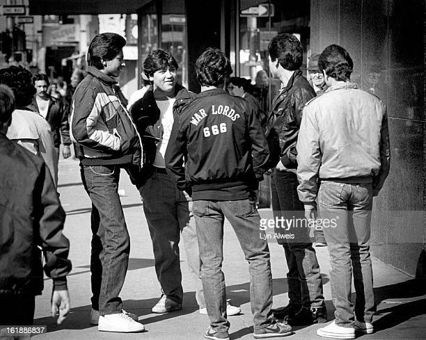 JAN 11 1984 FEB 12 1984 In front of Woolworths on 15th St by the bus stop on the far left is Juan Romerez 16 said he was ditching school everyone...