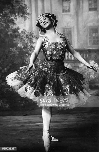 In full costume a happy Anna Pavlova strikes a pose for a photo postcard produced in Paris France around 1910
