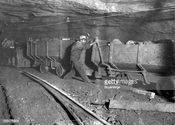 In Gary West Virginia a boy applies the brakes on a motor train 1908 He performs this task for around ten hours per day