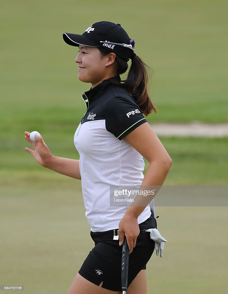 In Gee Chun from South Korea waves to the fans on the first green during the second round of the LPGA Volvik Championship on May 27, 2016 at Travis Pointe Country Club Ann Arbor, Michigan.