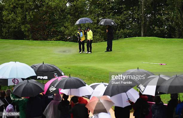 In Gee Chun of Korea trys to find a place to put her ball on the rain soaked second green during the final round of The Evian Championship on...