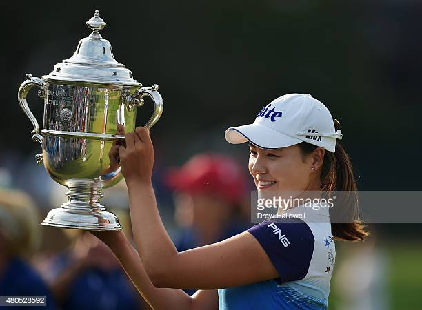 In Gee Chun of South Korea poses for photographs with the trophy after winning the US Women's Open at Lancaster Country Club on July 12 2015 in...