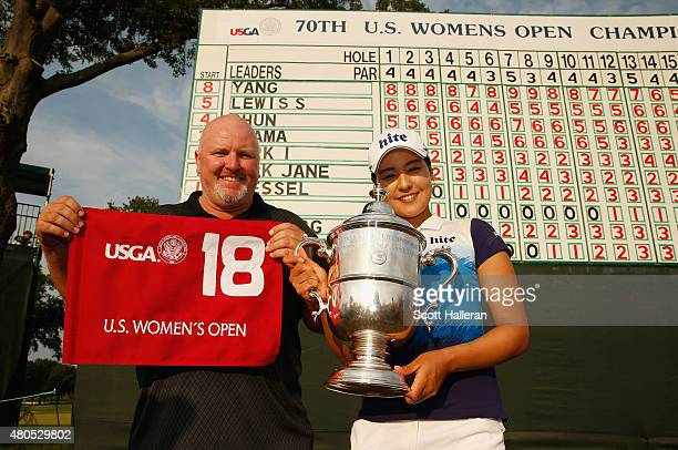 In Gee Chun of South Korea poses with the trophy and her caddie Dean Herden after winning the US Women's Open at Lancaster Country Club on July 12...