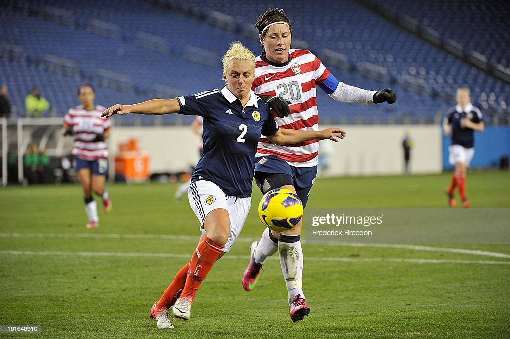 In her 200th game as a member of the U.S. Women's National Team, <a gi-track='captionPersonalityLinkClicked' href=/galleries/search?phrase=Abby+Wambach&family=editorial&specificpeople=162757 ng-click='$event.stopPropagation()'>Abby Wambach</a> #20 plays against Eilish McSorley #4 of the Scotland Women's National Team at LP Field on February 13, 2013 in Nashville, Tennessee.