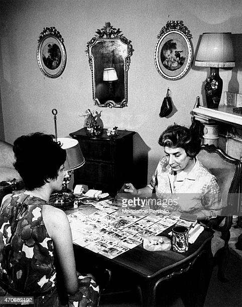 'In her study the soothsayer Maria Gardini one of the most famous fortuneteller all over Rome foretells the future of a woman with cards Rome 1966 '
