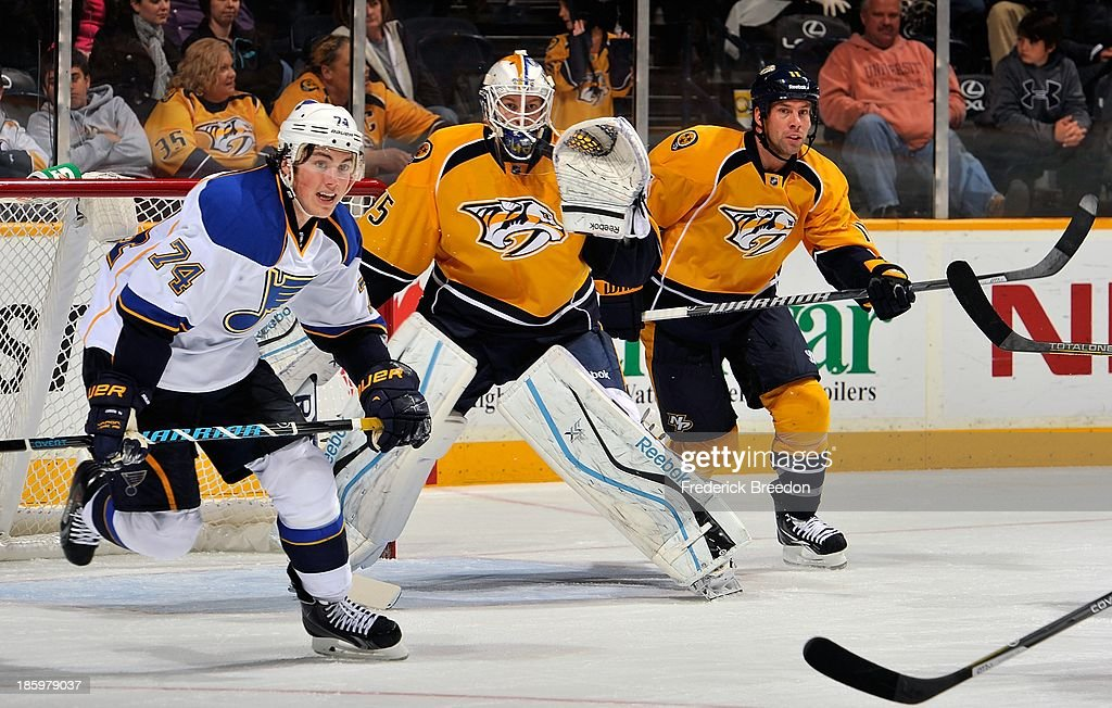 In his first career NHL game goalie Magnus Hellberg #45 of the Nashville Predators takes positon between teammate <a gi-track='captionPersonalityLinkClicked' href=/galleries/search?phrase=David+Legwand&family=editorial&specificpeople=202553 ng-click='$event.stopPropagation()'>David Legwand</a> #11 and <a gi-track='captionPersonalityLinkClicked' href=/galleries/search?phrase=T.J.+Oshie&family=editorial&specificpeople=700383 ng-click='$event.stopPropagation()'>T.J. Oshie</a> #74 of the St. Louis Blues at Bridgestone Arena on October 26, 2013 in Nashville, Tennessee.