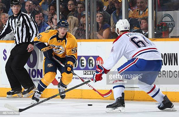 In his first NHL game Kevin Fiala of the Nashville Predators skates against Greg Pateryn of the Montreal Canadiens during an NHL game at Bridgestone...