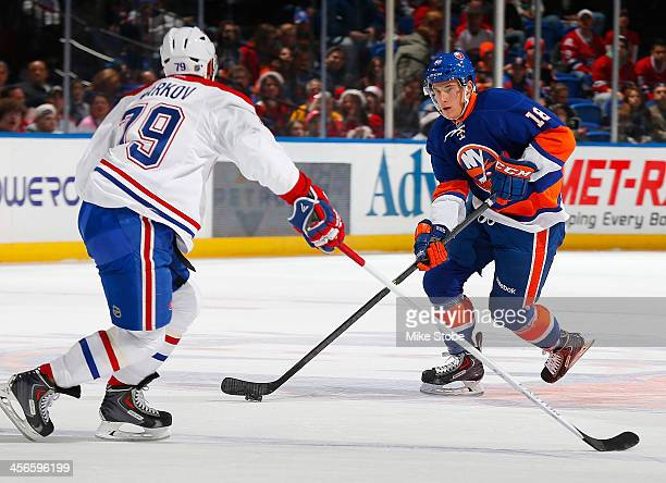 In his first NHL game Ryan Strome of the New York Islanders looks to shoot the puck past Andrei Markov of the Montreal Canadiens at Nassau Veterans...