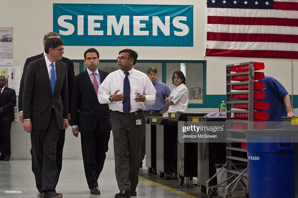In his first trip since taking office, (L-R) Treasury Secretary Jacob Lew tours a Siemens' manufacturing plant with Helmuth Ludwig, CEO Siemens Industry Sector North America, and plant manager Shujath Ali on March 14, 2013 in Alpharetta, Georgia. This Siemens facility manufactures drive components for major American industries. While in Atlanta, the Secretary will also meet with local business leaders to discuss the president's proposals to make America a magnet for new jobs and manufacturing, accelerate economic growth, and reduce our deficits.