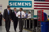 In his first trip since taking office Treasury Secretary Jacob Lew tours a Siemens' manufacturing plant with Helmuth Ludwig CEO Siemens Industry...