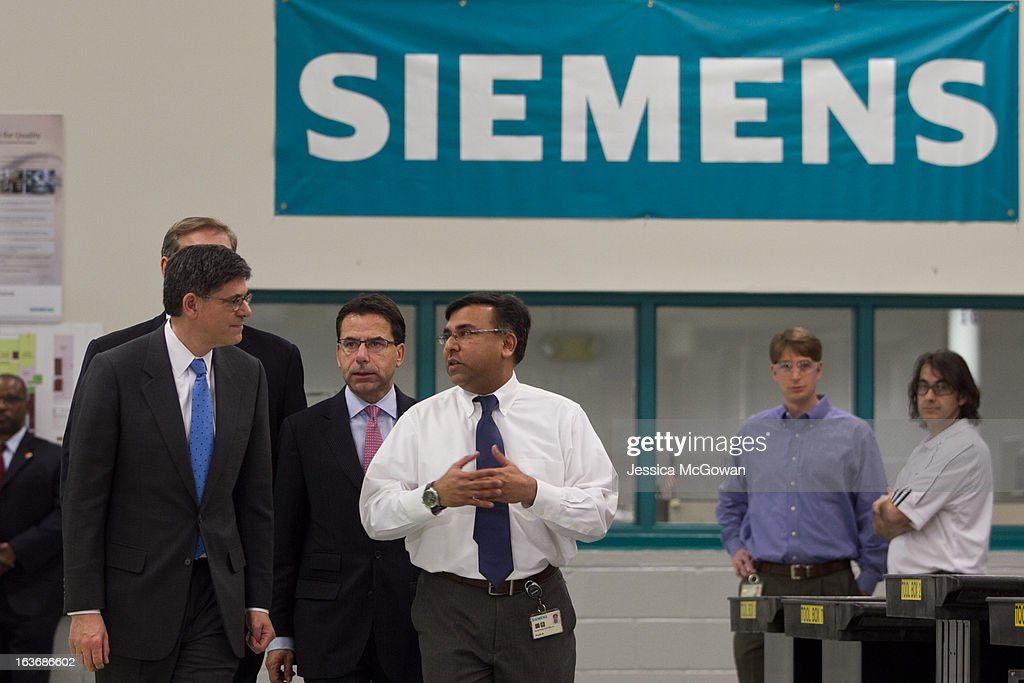 In his first trip since taking office, Treasury Secretary Jacob Lew (L) tours a Siemens' manufacturing plant with Helmuth Ludwig (2L), CEO Siemens Industry Sector North America, and plant manager Shujath Ali (C) on March 14, 2013 in Alpharetta, Georgia. This Siemens facility manufactures drive components for major American industries. While in Atlanta, the Secretary will also meet with local business leaders to discuss the president's proposals to make America a magnet for new jobs and manufacturing, accelerate economic growth, and reduce our deficits.