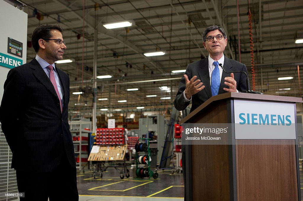 In his first trip since taking office, Treasury Secretary Jacob Lew (R) tours a Siemens' manufacturing plant and addresses the press alongside CEO Siemens Industry Sector North America Helmuth Ludwig on March 14, 2013 in Alpharetta, Georgia. This Siemens facility manufactures drive components for major American industries. While in Atlanta, the Secretary will also meet with local business leaders to discuss the president's proposals to make America a magnet for new jobs and manufacturing, accelerate economic growth, and reduce our deficits.