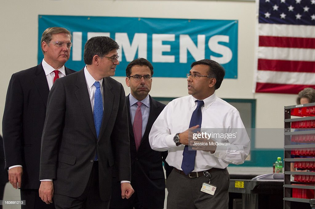 In his first trip since taking office, Treasury Secretary Jacob Lew (2nd L) tours a Siemens' manufacturing plant with Helmuth Ludwig, CEO Siemens Industry Sector North America, plant manager Shujath Ali and CEO Siemens USA Eric Spiegel (L) on March 14, 2013 in Alpharetta, Georgia. This Siemens facility manufactures drive components for major American industries. While in Atlanta, the Secretary will also meet with local business leaders to discuss the president's proposals to make America a magnet for new jobs and manufacturing, accelerate economic growth, and reduce our deficits.