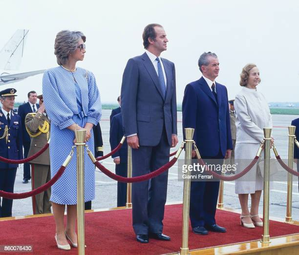 In his official visit to Romania the Spanish Kings Juan Carlos and Sofia are greeted at the airport by President Nicolae Ceaucescu and wife Bucharest...