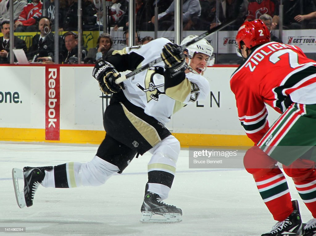 In his second game back from a concussion, Sidney Crosby #87 of the Pittsburgh Penguins takes the shot against the New Jersey Devils at the Prudential Center on March 17, 2012 in Newark, New Jersey.
