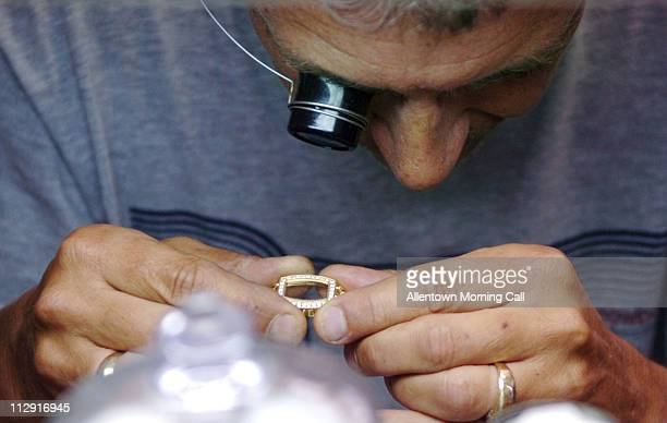 In his shop watchmaker Edward Christine of Allentown Pennsylvania repairs a woman's watch on June 19 2008 He said business seems to have slightly...