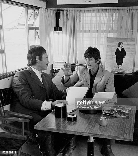 In his trailer Russianborn American Swiss actor Yul Brynner sits with costar American actor Charles Bronson during a break in the production of the...