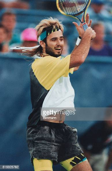 In his usual nontraditional tennis clothung Andre Agassi sporting a bread and longer hair in action at the US Open PH Jon Simon