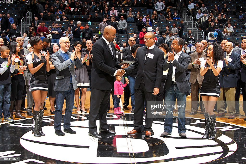 In honor of Black History Month, Brooklyn Nets General Manager Billy King presents descendants of historic African-American Basketball teams with a commemorative plaque during halftime of a game between the San Antonio Spurs and Nets on February 10, 2013 at the Barclays Center in the Brooklyn borough of New York City.