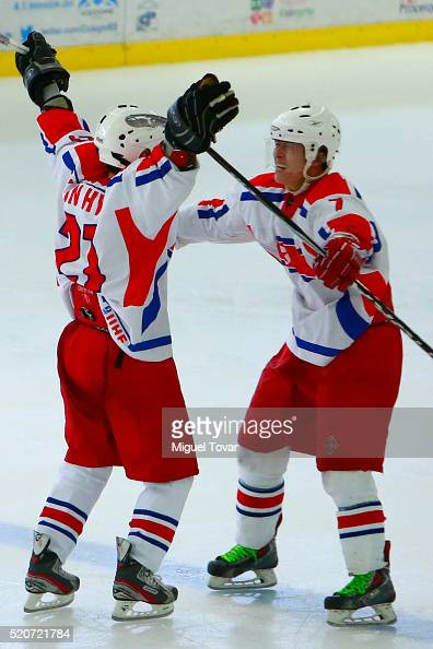 In Hyok Kang of Korea celebrates after a goal with Myoung Chol Kim during the match between New Zealand and Korea as part of the 2016 IIHF Ice Hockey...