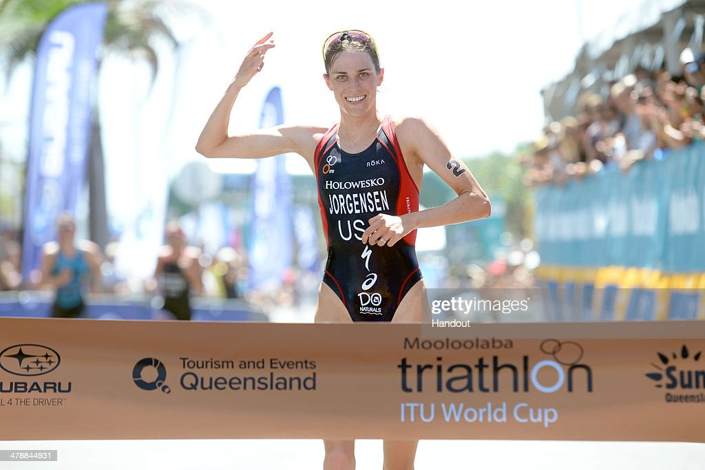 In In this handout photo provided by ITU (International Triathlon Union), USA's <a gi-track='captionPersonalityLinkClicked' href=/galleries/search?phrase=Gwen+Jorgensen&family=editorial&specificpeople=8022321 ng-click='$event.stopPropagation()'>Gwen Jorgensen</a> wins the women's race in the triathlon season opener at the 2014 Mooloolaba ITU Triathlon World Cup on March 15, 2014 in Mooloolaba, Australia. (Photo by ITU, Delly Carr via Getty Images).