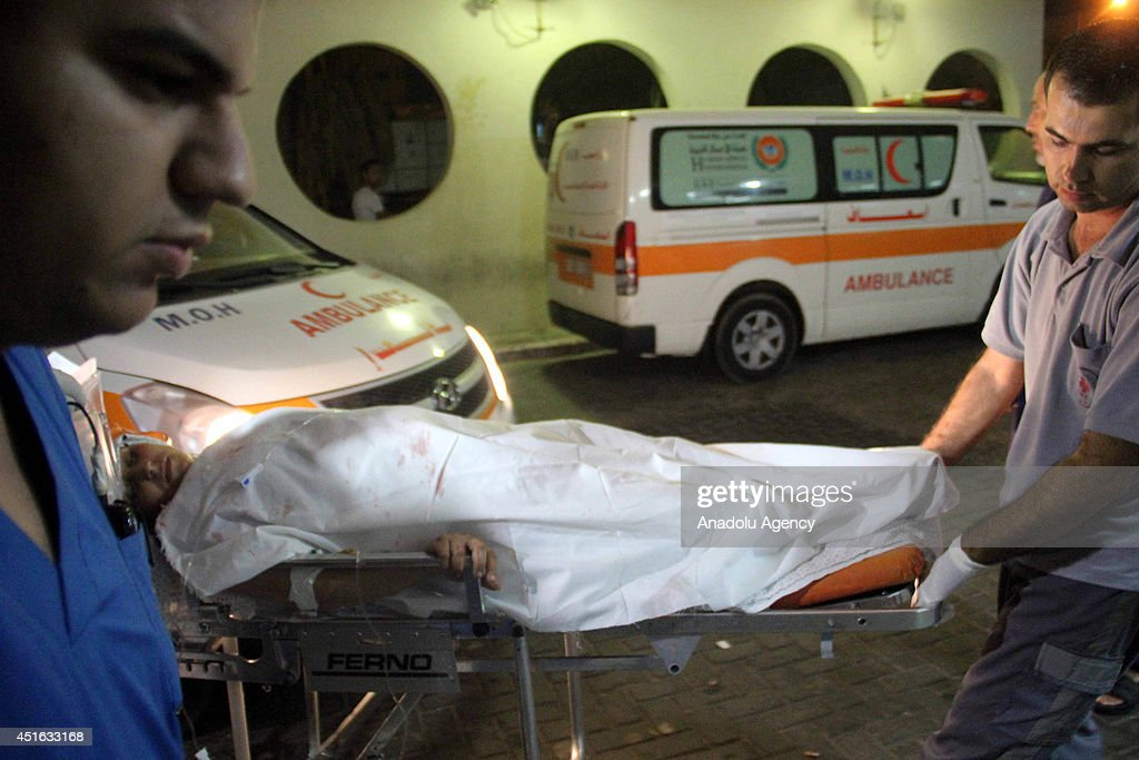 In Israeli air attacks to different part of Gaza Strip, including Beit Lahia, 5 Palestinians get wounded on July 3, 2014 in Gaza City, Gaza. A wounded Palestinian is taken to the hospital after the attack.