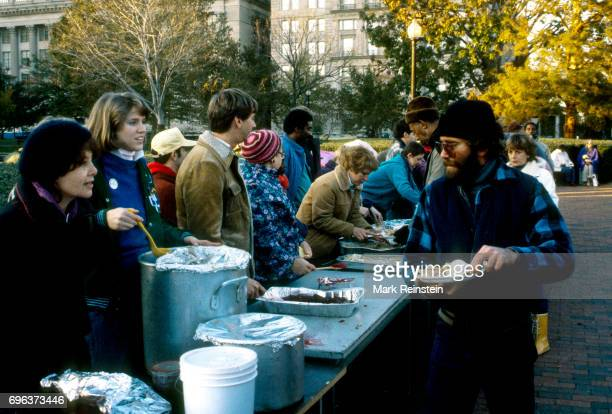 In Lafayette Park the staff of the Community of Creative NonViolence serve a Thanksgiving meal to the homeless and residents of local shelters...