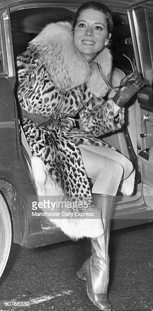 �In leopard skin and fox fur actress Diana Rigg former star of ITV�s �The Avengers� series arrives at London Airport to board a plane for Switzerland...