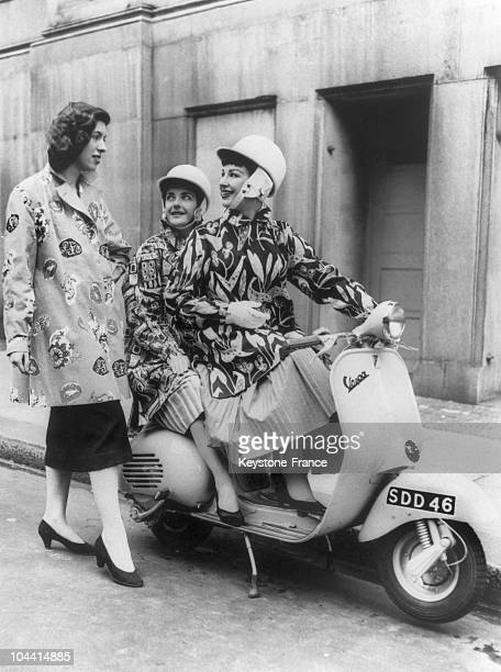 In London on July 10 two women on a VESPA nicknamed SCOOTICOAT made by MOSELEY