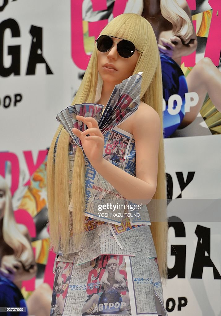 In newspaper made dress, US pop music star Lady Gaga look-alike doll, called Gagadoll made of silicon is displayed at a press conference in Tokyo on December 1, 2013. Lady Gaga is here for the promotion of her latest album 'ARTPOP'. AFP PHOTO / Yoshikazu TSUNO