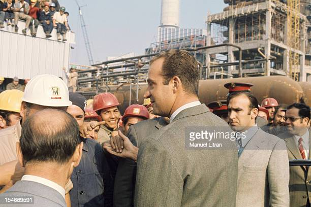 In November 1971 Princess Sophia and Prince Juan Carlos of Spain visit the city of Burgos in Castile and Leon Here the Prince in a factory shaking...