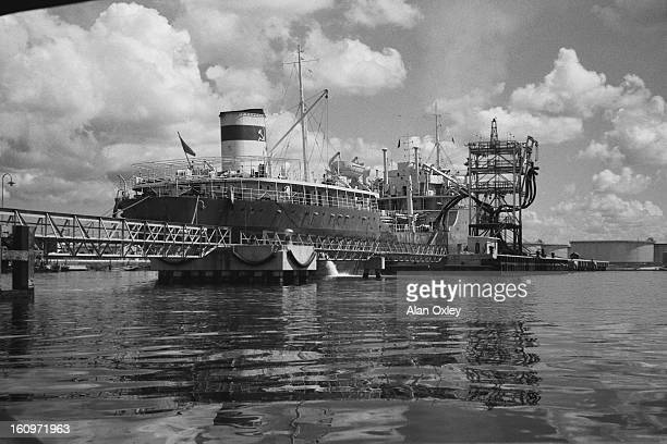 In October 1960 three months after Fidel Castro seizes foreign oil refineries for refusing to process Russian oil the Soviet tanker 'Pobho' unloads...