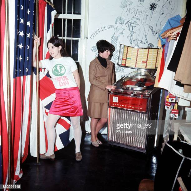 In Pauline Fordham's boutique in Ganton Street near Carnaby Street Customer Jackie Binder in a 'with it' blouse and skirt stands beside a dressing...