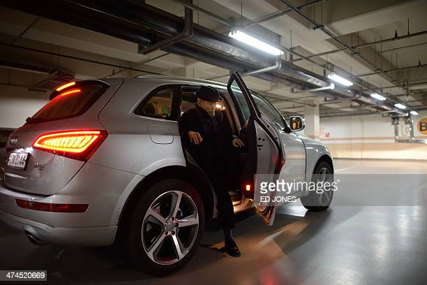 In photo taken on February 22 2014 Kim SeRin disembarks from a car as he arrives at his home in Seoul after returning from a family reunion with his...
