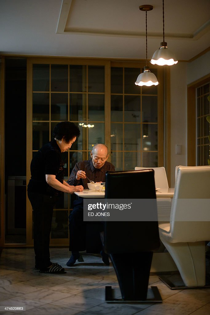 In photo taken on February 22, 2014 Kim Se-Rin (R) is served by his wife as he eats a meal in his home in Seoul after returning from a family reunion with his North Korean relatives. Among tens of thousands of wait-listed applicants, the 85-year-old was one of just 83 South Koreans chosen to participate in a meeting of family members divided by the 1950-53 Korean War. Kim left his hometown in the North Korean county of Hwangju in December 1950 at the height of the war to join the South Korean army, without telling his parents, his brother or his two sisters. In the six decades since, he had no contact with those he left behind, not knowing whether they were alive or dead. Millions of Koreans were separated by the conflict and permanent division of the peninsula. The joy of reunion is tempered by the pain of the inevitable -- and permanent -- separation at the end. Although he knew it would be near impossible to expect answers to more than 60 years worth of questions, Kim was grateful to have finally heard how his parents died and how his other relatives lived during the years since he left. Of the 125,000 South Koreans who have applied for reunions since 1988, 57,000 have died with time rapidly running out for those on the wait list. AFP PHOTO / Ed Jones