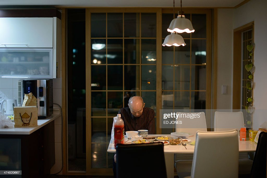 In photo taken on February 22, 2014 Kim Se-Rin prays before eating a mealat his home in Seoul after returning from a family reunion with his North Korean relatives. Among tens of thousands of wait-listed applicants, the 85-year-old was one of just 83 South Koreans chosen to participate in a meeting of family members divided by the 1950-53 Korean War. Kim left his hometown in the North Korean county of Hwangju in December 1950 at the height of the war to join the South Korean army, without telling his parents, his brother or his two sisters. In the six decades since, he had no contact with those he left behind, not knowing whether they were alive or dead. Millions of Koreans were separated by the conflict and permanent division of the peninsula. The joy of reunion is tempered by the pain of the inevitable -- and permanent -- separation at the end. Although he knew it would be near impossible to expect answers to more than 60 years worth of questions, Kim was grateful to have finally heard how his parents died and how his other relatives lived during the years since he left. Of the 125,000 South Koreans who have applied for reunions since 1988, 57,000 have died with time rapidly running out for those on the wait list. AFP PHOTO / Ed Jones