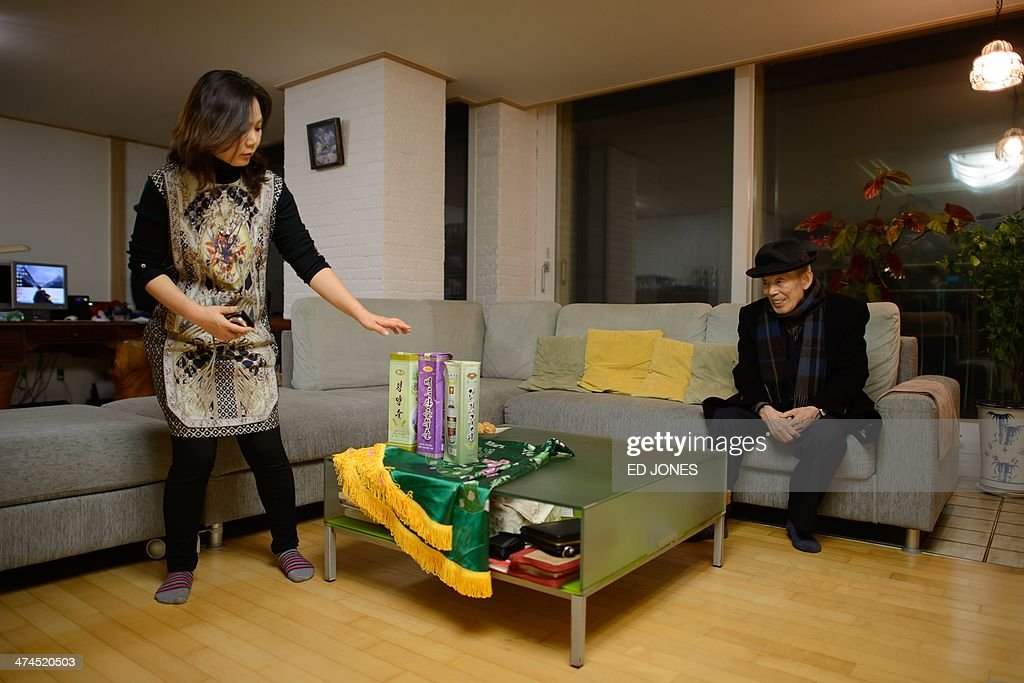 In photo taken on February 22, 2014 Kim Se-Rin (R) sits after arriving at his home in Seoul after returning from a family reunion with his North Korean relatives, as his daughter Kim Young-Soon (L) unpacks gifts brought back from North Korea. Among tens of thousands of wait-listed applicants, the 85-year-old was one of just 83 South Koreans chosen to participate in a meeting of family members divided by the 1950-53 Korean War. Kim left his hometown in the North Korean county of Hwangju in December 1950 at the height of the war to join the South Korean army, without telling his parents, his brother or his two sisters. In the six decades since, he had no contact with those he left behind, not knowing whether they were alive or dead. Millions of Koreans were separated by the conflict and permanent division of the peninsula. The joy of reunion is tempered by the pain of the inevitable -- and permanent -- separation at the end. Although he knew it would be near impossible to expect answers to more than 60 years worth of questions, Kim was grateful to have finally heard how his parents died and how his other relatives lived during the years since he left. Of the 125,000 South Koreans who have applied for reunions since 1988, 57,000 have died with time rapidly running out for those on the wait list. AFP PHOTO / Ed Jones