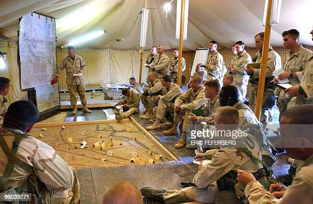 In preparation for a USled war against Iraq US marines Captain Brian Ross from the 2nd Bat/8th shows a map of Iraq and briefs his staff about the...