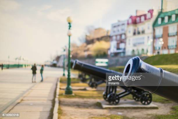 In Quebec City, cannons of Dufferin Terrace, promenade right above the St Lawrence river not far from the Château Frontenac Hotel.