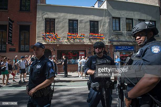 In reaction to the mass shooting at a gay nightclub in Orlando Florida members of the NYPD Counterterrorism Unit stand outside the Stonewall Inn near...