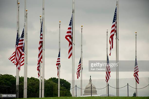 In response to the shootings in Aurora CO theatre shootings flags are at half staff at the Washingotn Monument in Washington DC and across the...