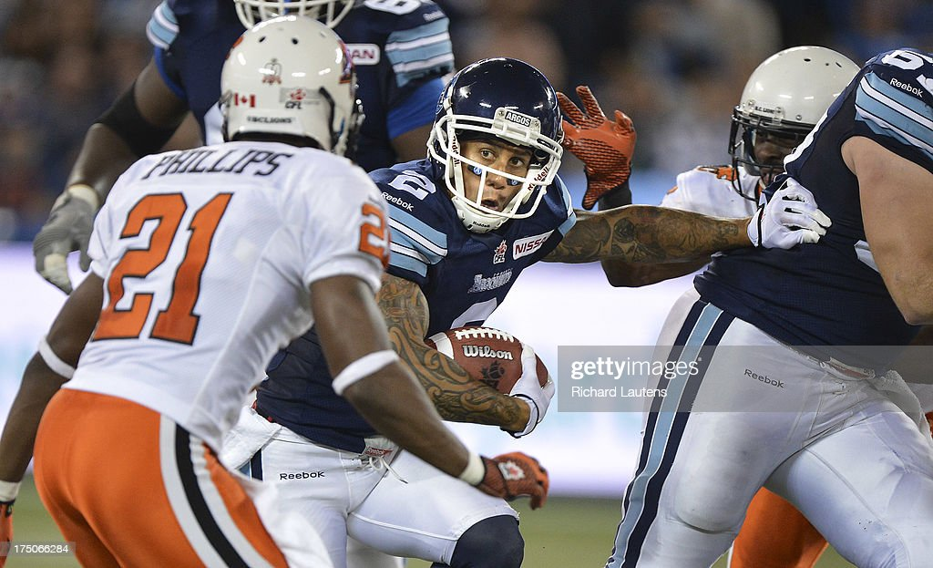 TORONTO, ON - JULY 30 - In second half action, The Argos' Chad Owens runs for a first down. The Toronto Argonauts beat the BC Lions 38-12 at the Rogers Centre in Toronto. The Argos were without their starting quarter back and running back. July 30, 2013.
