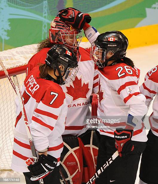 In second period action after yet another great save Canada's Cherie Piper and Canada's Sarah Vaillancourt congratulate goalie Canada's Shannon...