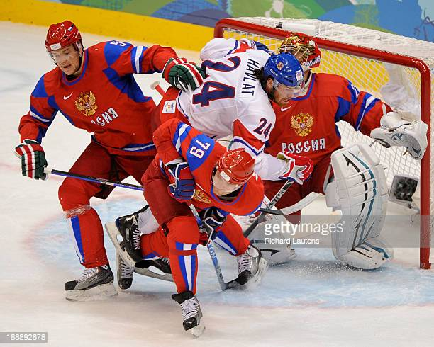 In second period action Czech Republic's Martin Havlat is surrounded by Russia's Andrey Markov Russia's Ilya Nikulin and goalie Russia's Evgeny...
