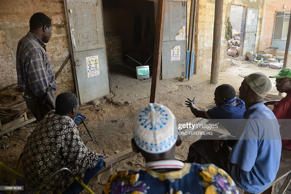 In Segou on January 24, 2013 spectators watch the Africa Cup of Nations football match between Mali and Ghana, which Mali lost.